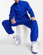 ASOS DESIGN - Blåt træningssæt med sweatshirt med halv lynlås og super-oversized joggingbukser med løbesnore i buksekanterne